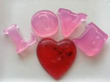 Red Palm Oil tinted alphabet with raspberry oil. Rose hearts